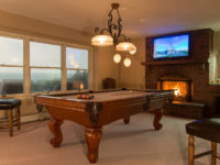 game room with pool table and tv